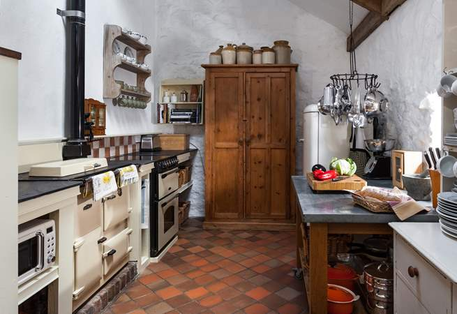 The cottage Rayburn helps create a wonderful warm welcome.