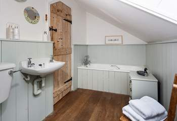 The cottage-style family bathroom.