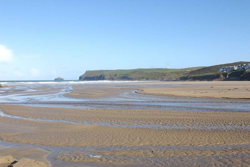 The golden sands at Polzeath - a favourite with surfers and families alike.