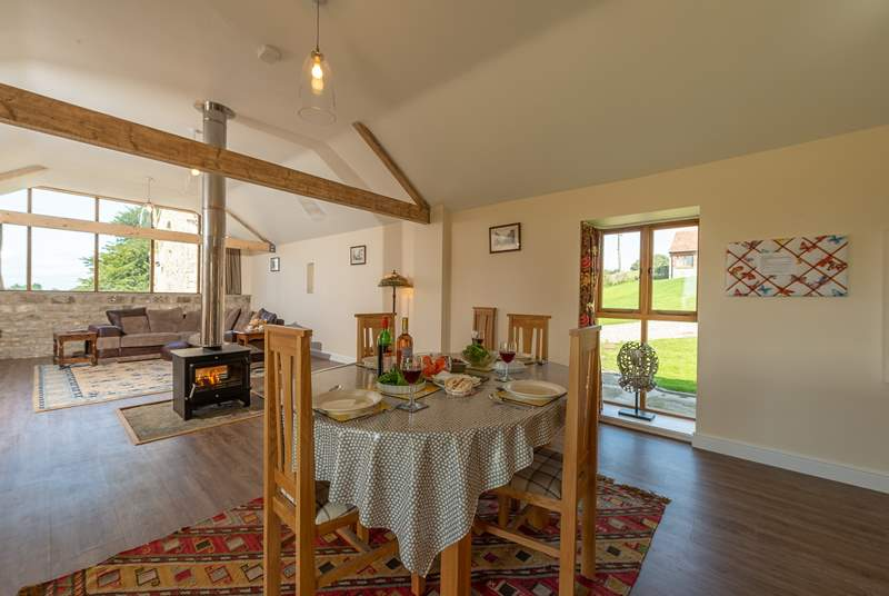 There is the most fabulous open plan living space with a double-sided wood-burning stove at its heart.