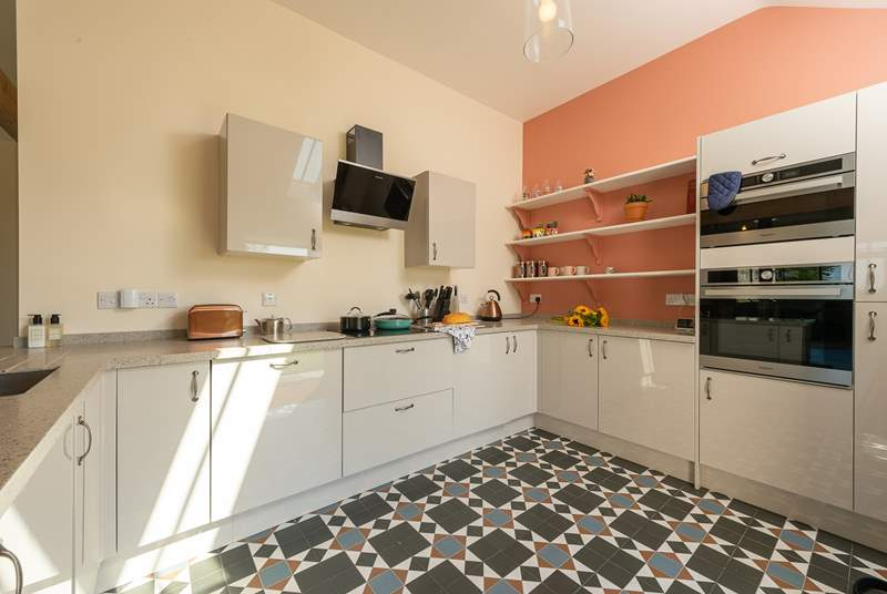 The kitchen is bright and cheerful, and equipped with all that you could possibly want for your stay here.