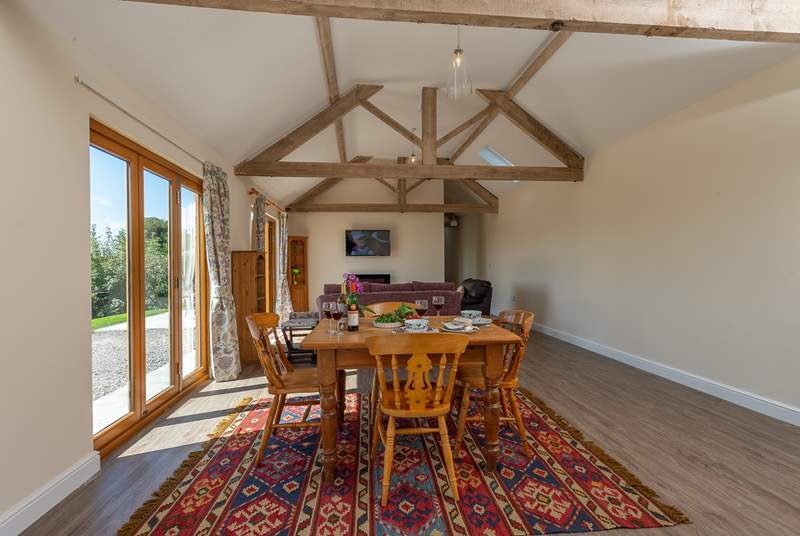 The open plan living-room has the original beams for perfect character.