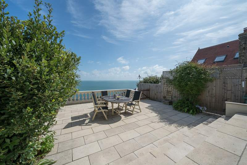 This stunning patio area has the most incredible sea views. Please take care on the patio as the wall is low and the steps that lead down to the lower garden area are steep and uneven.
