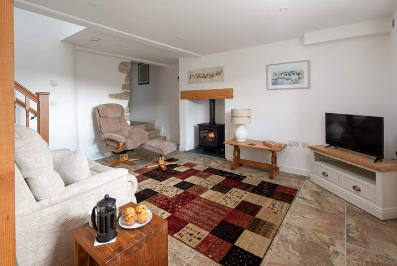 The cosy electric wood-burner really makes this room feel cosy and homely, especially on chillier nights.