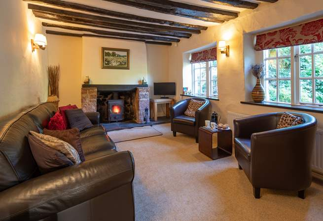 The cosy sitting-room is perfect for snuggling up in following a full day of adventure.