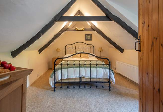 Bedroom 2 on the first floor is super inviting, however please do mind your head on the beautiful beams.