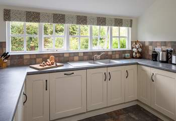The kitchen has a fabulous leafy view.