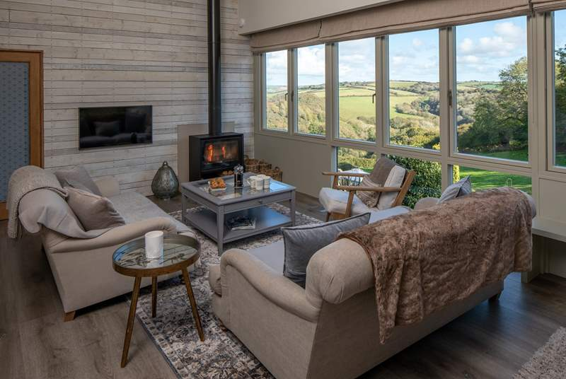 The living area is the perfect place to relax and unwind following a fun-packed day, especially with a full Sky package available along with the glorious wood-burner.