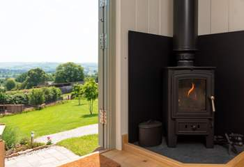 The warming wood-burner ensures cosiness whatever the time of year.