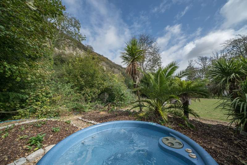 Within the grounds, set back from the house,  you can relax in the hot tub in complete privacy.