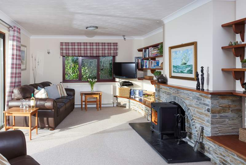Trefechan has a wonderful cosy sitting-room with patio doors out to the terrace and garden. (Please note as of 13th March, the wood-burner is currently not in use).