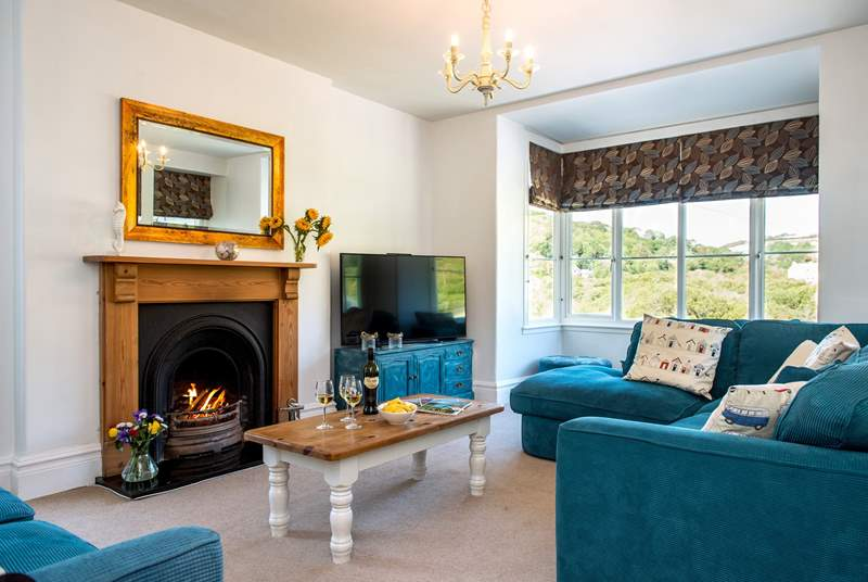 The cosy sitting-room has an open fire, ideal for those out-of-season breaks.