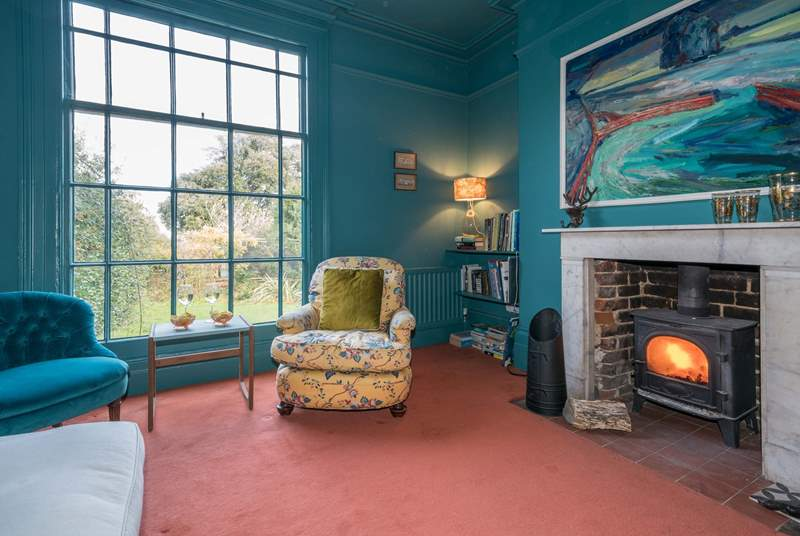 Light the wood-burner and relax in the family sitting-room.
