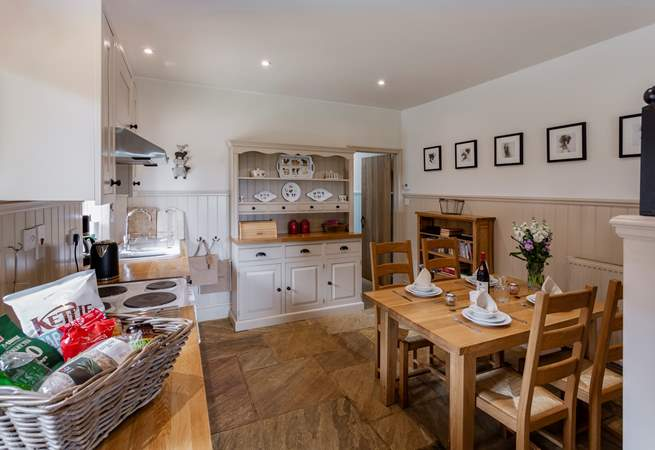 The well-equipped farmhouse-style kitchen and dining area.