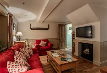 Cosy living space with feature fireplace.