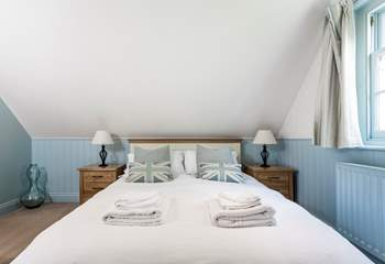 The relaxing blue tones of the bedroom with king-size double bed.