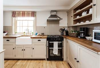 The fully equipped kitchen is perfect for preparing that special meal.