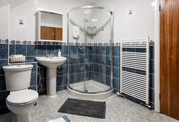 The shower cubicle in the bathroom.