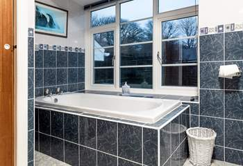 The family bathroom with bath and shower cubicle.