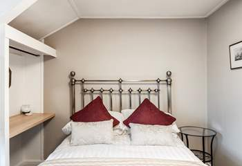 Bedroom 5 with its cosy double bed.