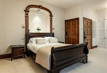 Bedroom 1 with king-size bed and elegant period features overlooks the square.