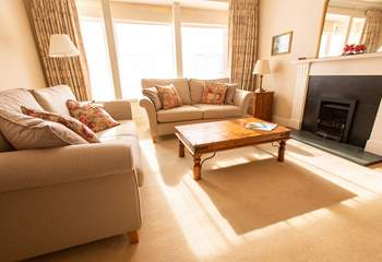 Cosy sitting-room with window overlooking St Davids' square.