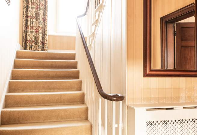 Elegant stair case leading to all bedrooms on first and second floor.