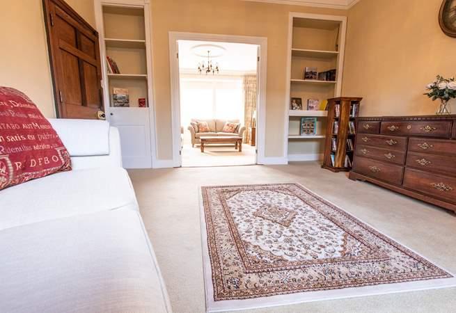 Snug leading onto sitting room,  doors open for family entertaining.
