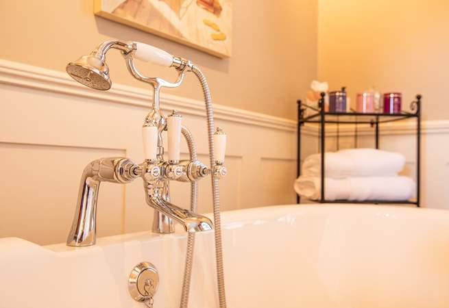 Convenient shower head over bath.