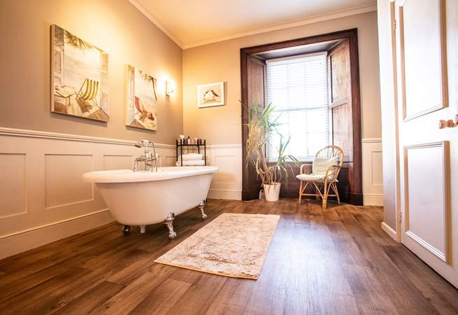 Family bathroom on the first floor with bath, separate shower and double wash-basins.