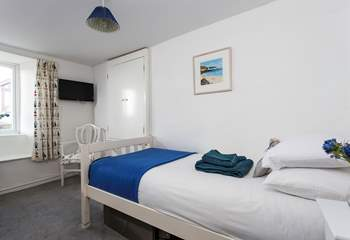This is the very pretty single bedroom which has lovely views over Crantock and you can even see the church.