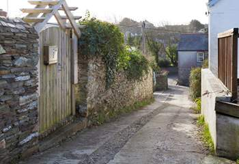 This view is taken from the lane, looking down towards Crantock. Langurra is behind the wooden gate on the left-hand side.