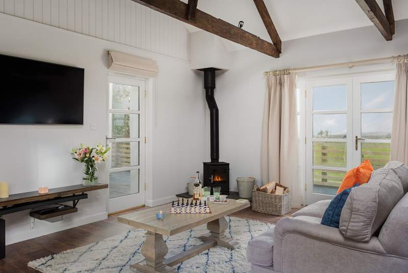 Stargazy has a wonderful sitting-area with doors that lead out onto the decked terrace and garden.