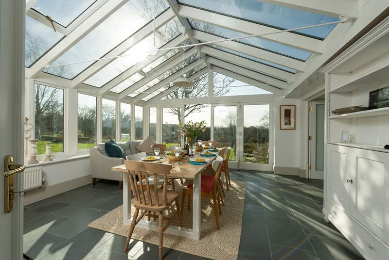 The fabulous garden-room makes a lovely dining-room. The double doors to the right lead into the main sitting-room.