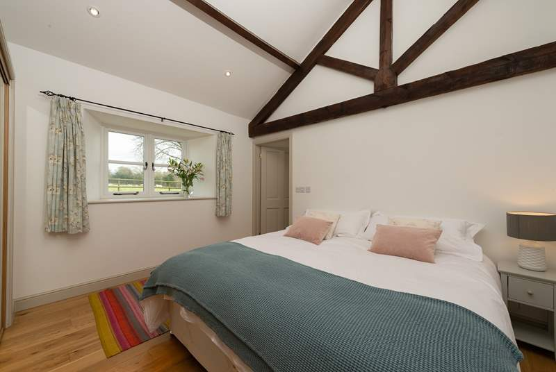 This bedroom can be set up as a super-king double or as twin beds. It looks out over the cottage's own garden and to the field beyond.