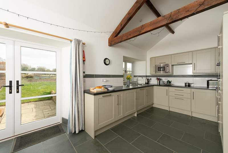 There is a really well-equipped fitted kitchen. French doors take you out onto your patio and to your own private garden overlooking fields.