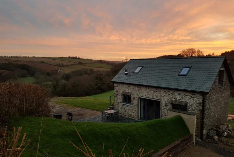 A sunrise view from the field above the barn, the grass bank at over six foot tall gives you total privacy from the owners.  In no way is your privacy compromised.