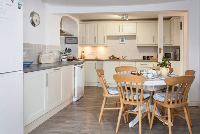 The lovely Shaker-style kitchen has a small dining-table if you fancy a more laid back lunch.