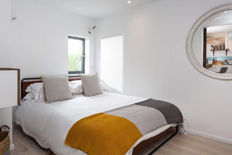 The comfortable ground floor bedroom with its king-size bed.