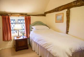 Single bedroom with en suite and views out onto the garden.