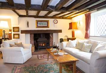 Large sitting-room with welcoming wood-burner.