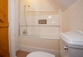 En suite bathroom with shower attachment.