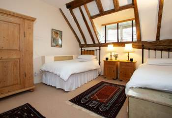 Spacious twin bedroom with views onto the garden.