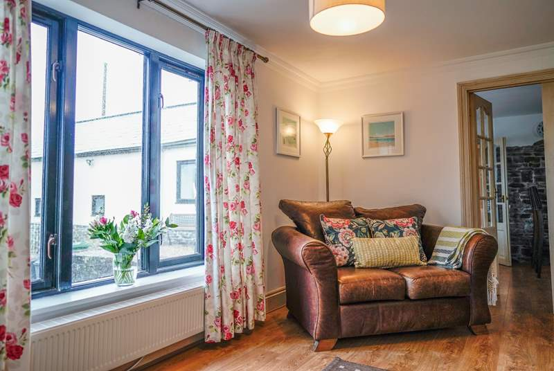 The sitting-room offers a family room with comfortable sofas and chairs, and views from every window.