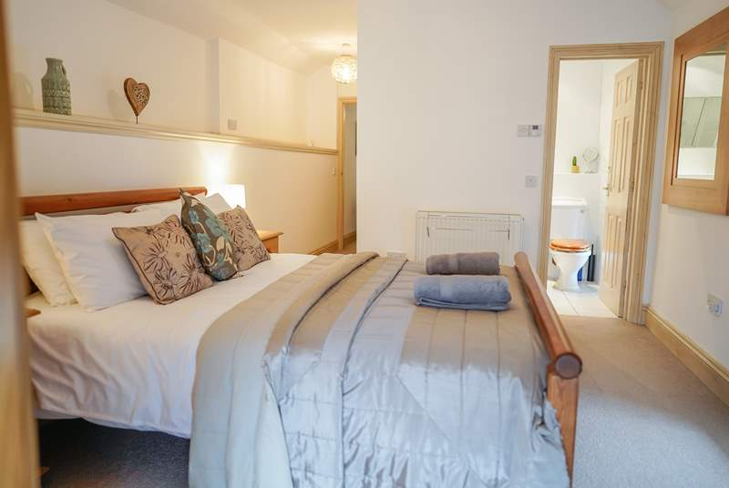 The master en suite bedroom is a spacious room at the opposite end of the barn to the sitting-room.