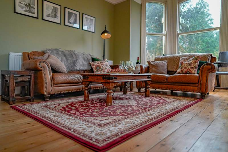 The sitting-room is situated to the front of the house and floods with light with wonderful views of the garden and beyond, not forgetting the log-burner for those colder nights.