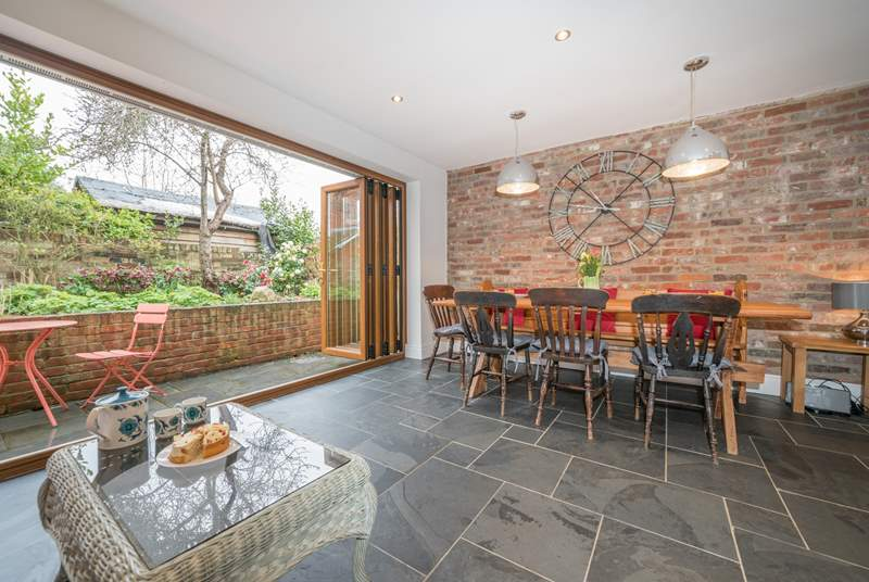The open plan layout from the kitchen/dining-room is emphasised with the bi-folding doors leading to the patio area.