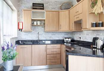 Fully equipped kitchen with granite worktops.