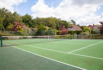 Practise your tennis skills on the all-weather tennis court.