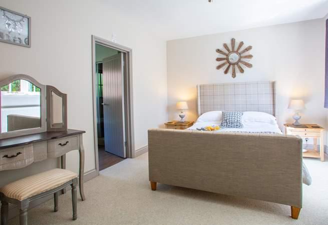 Spacious bedroom with door to en suite.